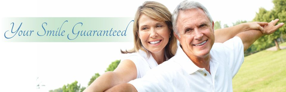 smiling senior couple with dentures in Saskatoon | Your Smile Guaranteed